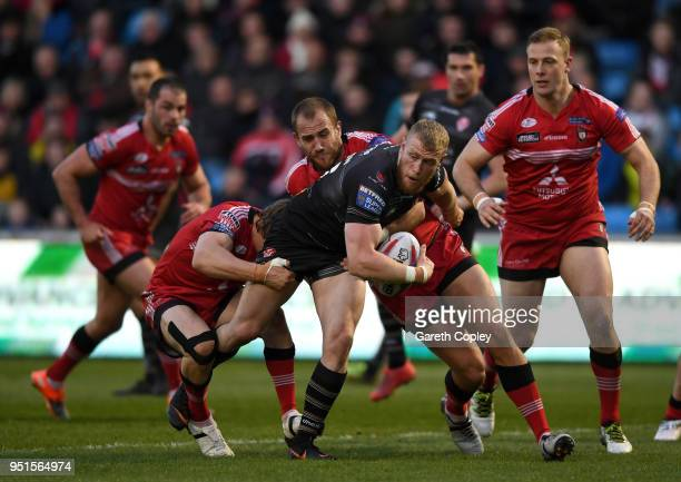 Luke Thompson of St Helens looks to offload during the Betfred Super League match between Salford Red Devils and St Helens at AJ Bell Stadium on...