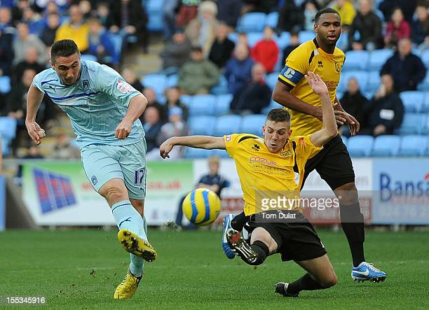 Luke Thurlbourne of Arlesey fails to stop Callum Ball of Coventry City from scoring the opening goal during the FA Cup With Budweiser 1st Round match...