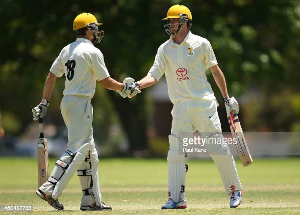 Luke Towers of Western Australia congratulates Ashton Turner after scoring his half century during day two of the Futures League match between...