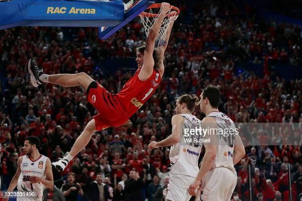 Luke Travers of the Wildcats hangs from the basket during game three of the NBL Semi-Final Series between the Perth Wildcats and the Illawarra Hawks...