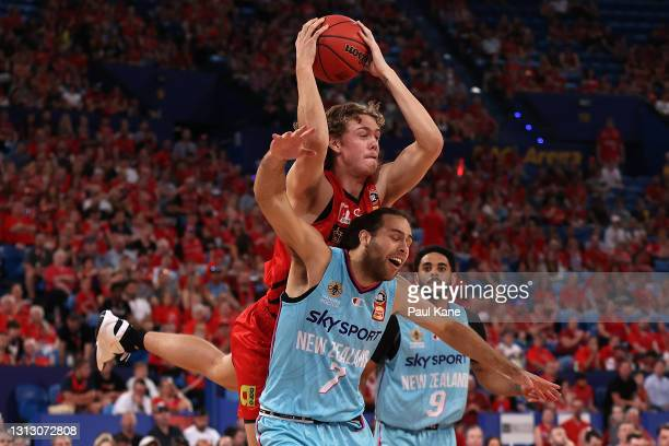 Luke Travers of the Wildcats looks to rebound against William Mcdowell-White of the Breakers during the round 14 NBL match between the Perth Wildcats...