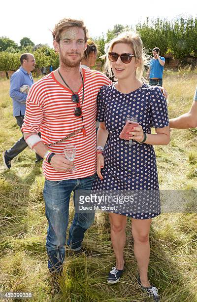 Luke Treadaway and Maddie Whitney attend The Mulberry Wilderness Picnic with Cara Delevingne during Wilderness 2014 at Cornbury Park on August 9 2014...