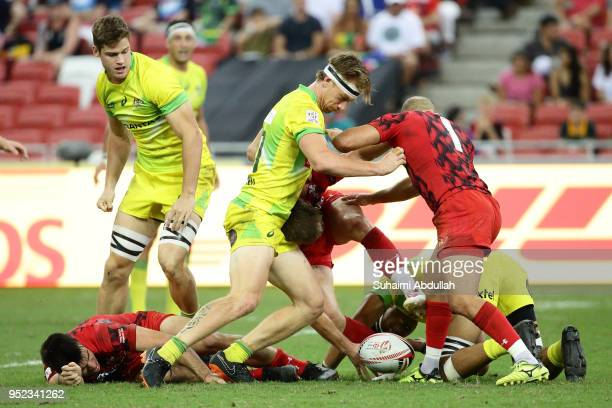 Luke Treharne of Wales and Ben O'Donnell of Australia challenge for the ball during the 2018 Singapore Sevens Pool D match between Wales and...