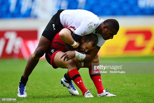 Luke Treharne of Wales is tackled by Jasa Veremalua of Fiji during the pool match between Fiji and Wales on day two of the HSBC Paris Sevens at the...