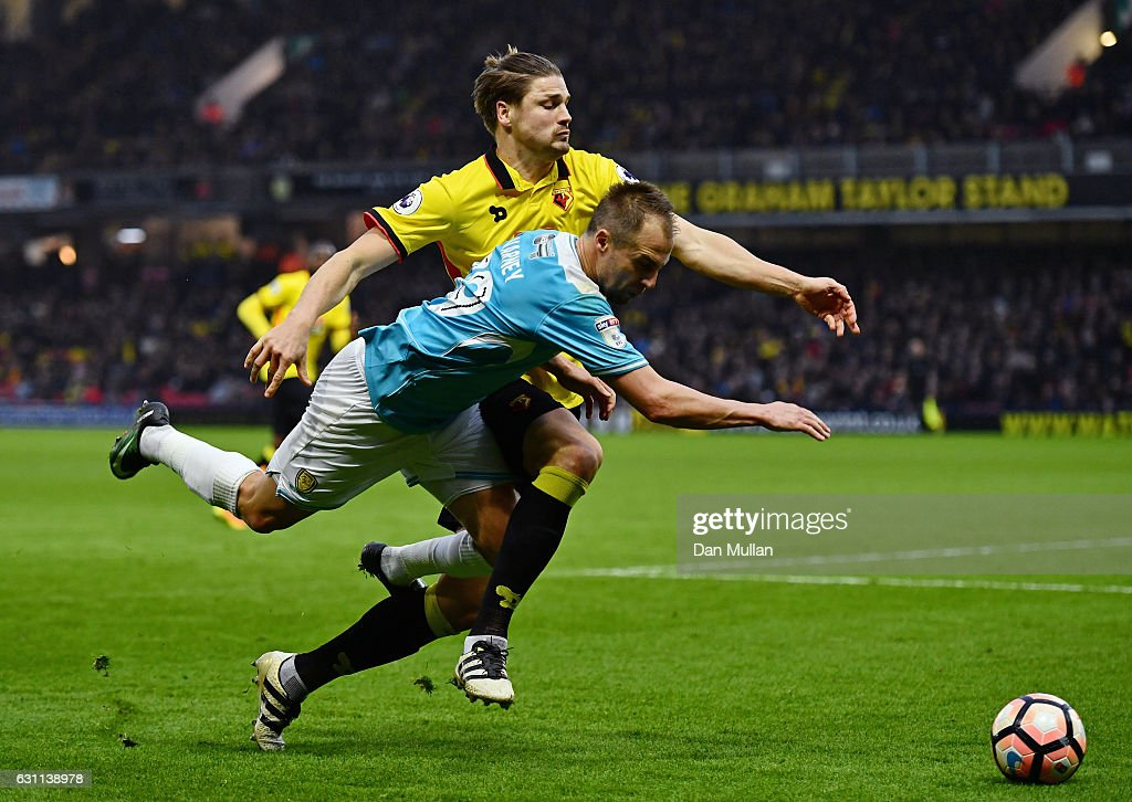Luke Varney of Burton Albion and Sebastian Prodl of Watford in action during The Emirates FA Cup Third Round match between Watford and Burton Albion at Vicarage Road on January 7, 2017 in Watford, England.