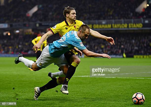 Luke Varney of Burton Albion and Sebastian Prodl of Watford in action during The Emirates FA Cup Third Round match between Watford and Burton Albion...
