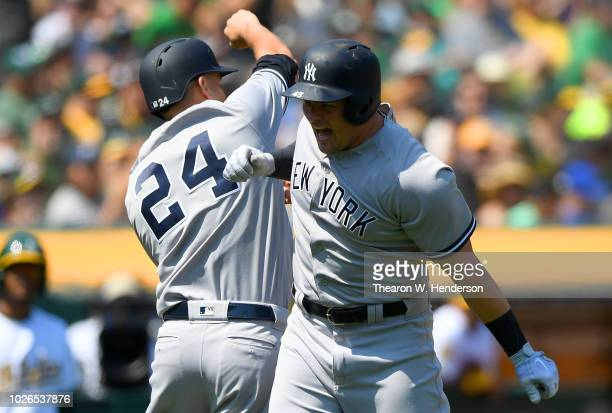 Luke Voit and Gary Sanchez of the New York Yankees celebrates after Voit hit a two-run home run against the Oakland Athletics in the top of the...