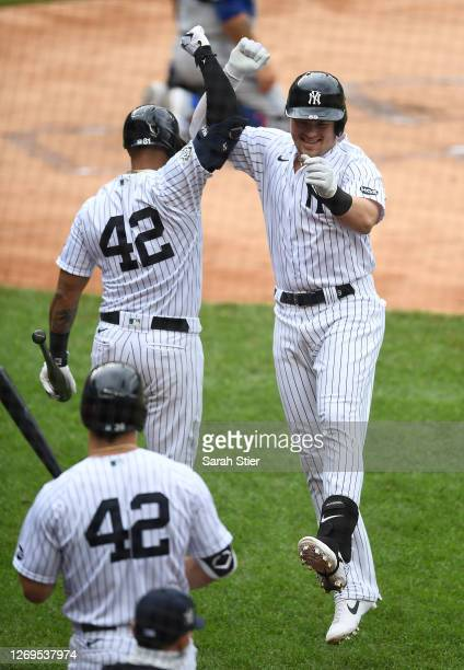Luke Voit celebrates with Aaron Hicks of the New York Yankees after hitting a home run during the first inning against the New York Mets at Yankee...
