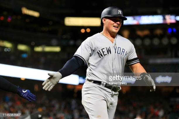 Luke Voit of the New York Yankees celebrates a two-run home run during the ninth inning against the San Francisco Giants at Oracle Park on April 26,...