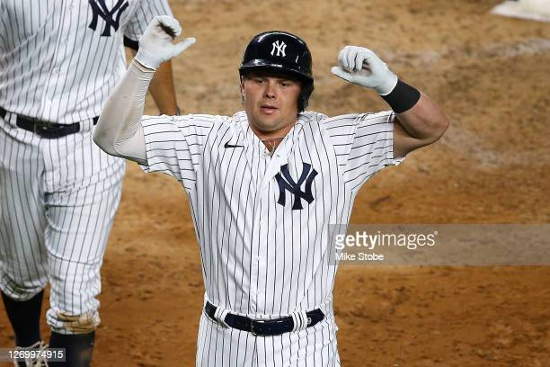 Luke Voit of the New York Yankees celebrates after hitting a 2-run home run to left field in the eighth inning against the Tampa Bay Rays at Yankee...