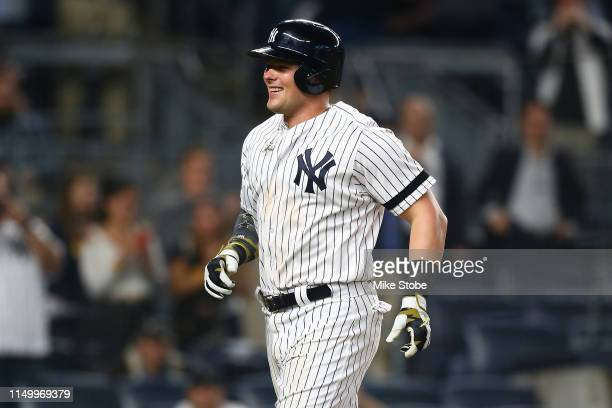 Luke Voit of the New York Yankees celebrates after hitting a home run in the ninth inning against the Tampa Bay Rays at Yankee Stadium on May 17 2019...