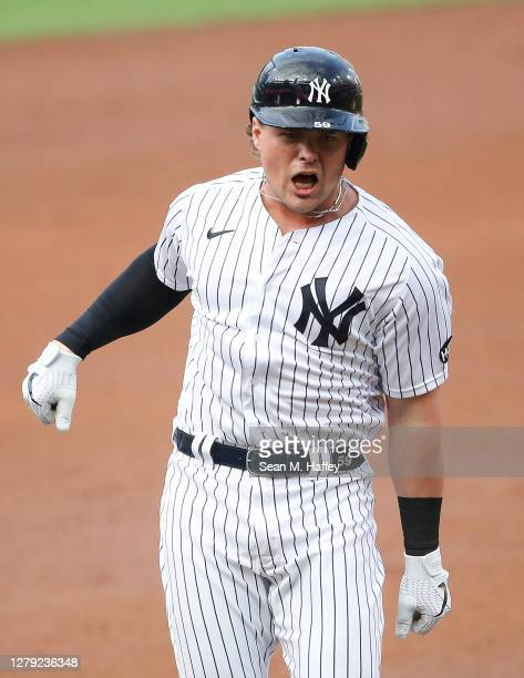 Luke Voit of the New York Yankees celebrates after hitting a solo home run against the Tampa Bay Rays during the second inning in Game Four of the...
