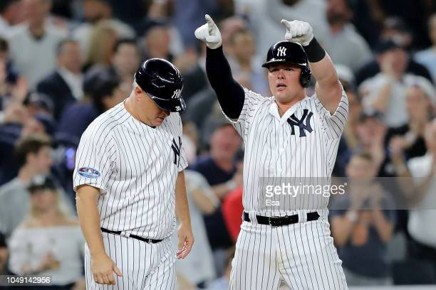 Luke Voit of the New York Yankees celebrates after hitting two RBI triple against the Oakland Athletics during the sixth inning in the American...