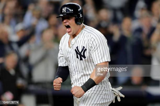 Luke Voit of the New York Yankees celebrates after scoring a run at home plate against Jonathan Lucroy of the Oakland Athletics off of Didi Gregorius...
