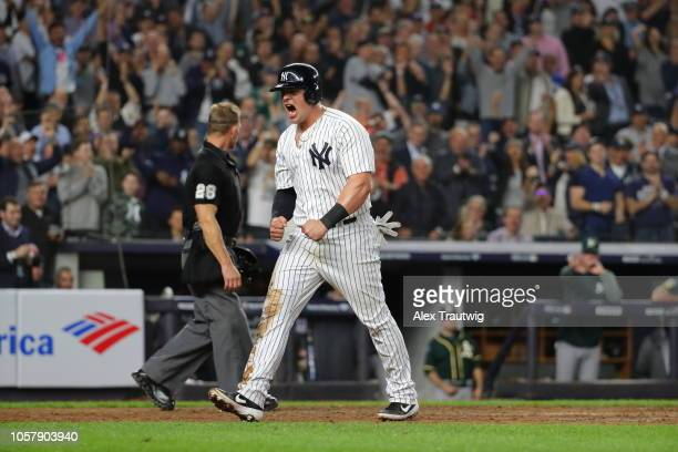 Luke Voit of the New York Yankees celebrates after scoring a run during the American League Wild Card game against the Oakland Athletics at Yankee...