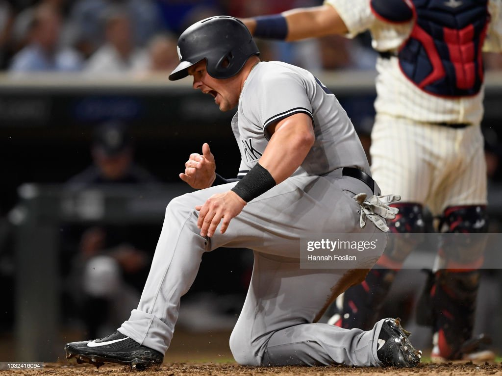 Luke Voit #45 of the New York Yankees celebrates scoring a run against the Minnesota Twins during the eighth inning of the game on September 12, 2018 at Target Field in Minneapolis, Minnesota. The Twins defeated the Yankees 3-1.