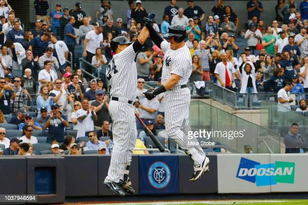 Luke Voit of the New York Yankees celebrates with Gary Sanchez after hitting a home run in the second inning against the Baltimore Orioles at Yankee...