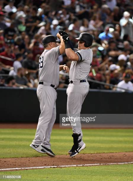 Luke Voit of the New York Yankees celebrates with third base coach Phil Nevin after hitting a solo home run during the sixth inning off of Merrill...