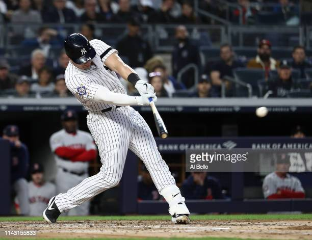 Luke Voit of the New York Yankees drives in a run with a hit in the fourth inning against the Boston Red Sox during their game at Yankee Stadium on...