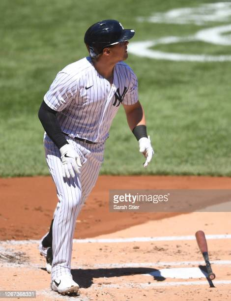 Luke Voit of the New York Yankees drops his bat after hitting a home run during the first inning against the Tampa Bay Rays at Yankee Stadium on...
