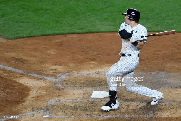 Luke Voit of the New York Yankees follows through after hitting a two-run home run during the fifth inning against the Tampa Bay Rays at Yankee...