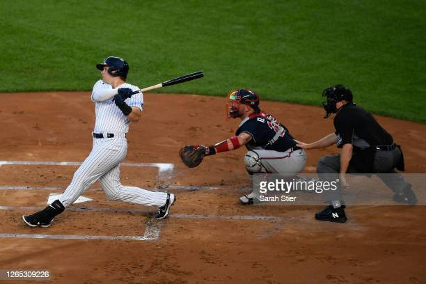 Luke Voit of the New York Yankees follows through on a three-run home run during the first inning against the Atlanta Braves at Yankee Stadium on...