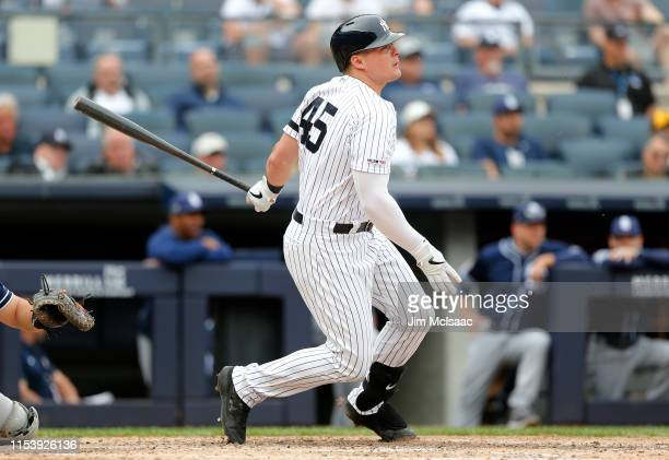 Luke Voit of the New York Yankees follows through on a triple against the San Diego Padres at Yankee Stadium on May 29 2019 in New York City