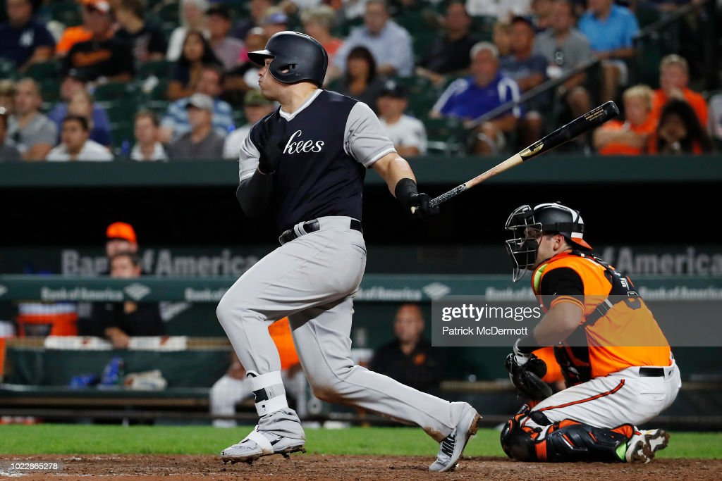 Luke Voit #45 of the New York Yankees hits a two-run home run in the tenth inning against the Baltimore Orioles at Oriole Park at Camden Yards on August 24, 2018 in Baltimore, Maryland.