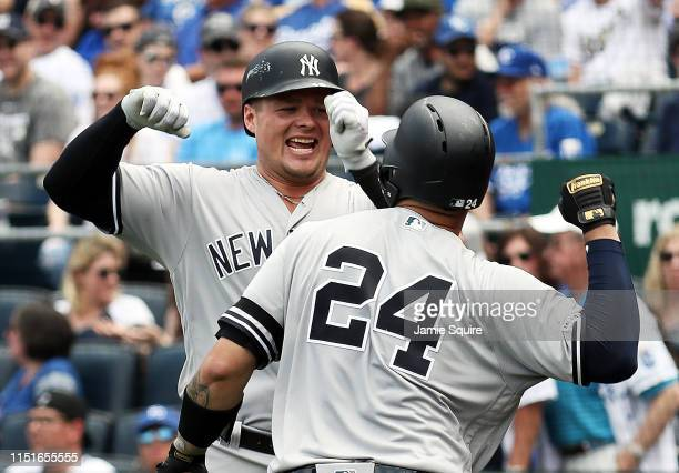 Luke Voit of the New York Yankees is congratulated by Gary Sanchez after hitting a two-run home run during the 7th inning of the game against the...