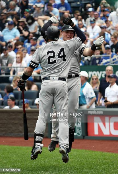 Luke Voit of the New York Yankees is congratulated by Gary Sanchez after hitting a tworun home run during the 7th inning of the game against the...
