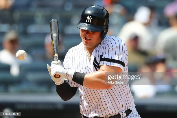 Luke Voit of the New York Yankees is hit in the mouth with a pitch in the fourth inning against the Colorado Rockies at Yankee Stadium on July 20,...