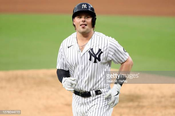 Luke Voit of the New York Yankees reacts after flying out against the Tampa Bay Rays during the sixth inning in Game Four of the American League...