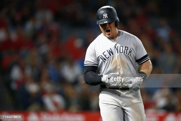 Luke Voit of the New York Yankees reacts after flying out during the eighth inning of a game against the Los Angeles Angels of Anaheim at Angel...