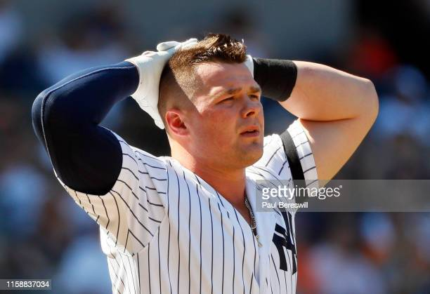 Luke Voit of the New York Yankees reacts after he strikes out looking to end the 8th inning of an MLB baseball game against the Houston Astros on...