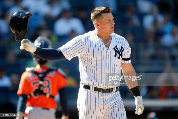 Luke Voit of the New York Yankees reacts after striking out to end the eighth inning against the Houston Astros at Yankee Stadium on June 23 2019 in...