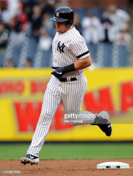 Luke Voit of the New York Yankees rounds the bases after hitting a two-run home run in the first inning against the Seattle Mariners at Yankee...