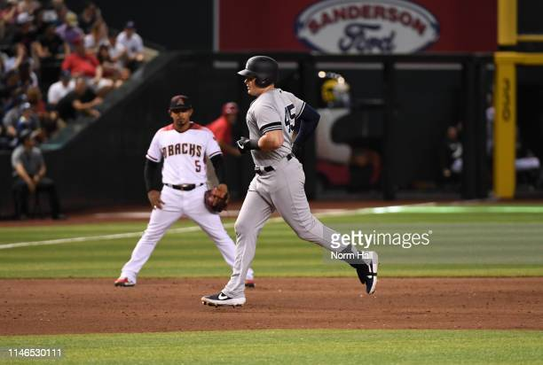 Luke Voit of the New York Yankees rounds the bases after hitting a solo home run during the sixth inning off of Merrill Kelly of the Arizona...