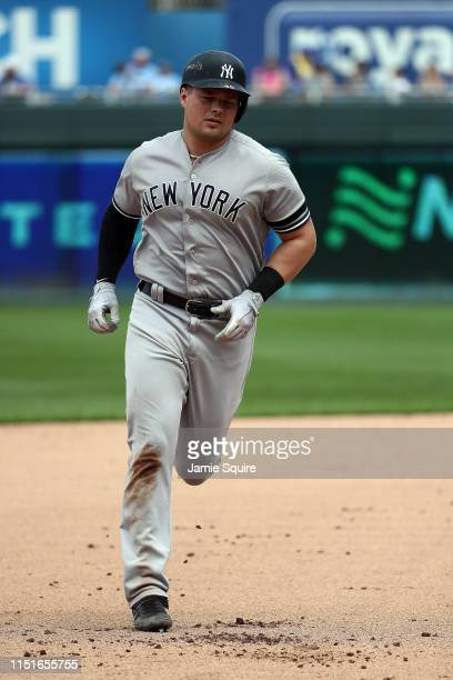 Luke Voit of the New York Yankees rounds the bases after hitting a tworun home run during the 7th inning of the game against the Kansas City Royals...