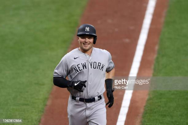 Luke Voit of the New York Yankees rounds the bases after hitting a first inning grand slam against the Baltimore Orioles at Oriole Park at Camden...