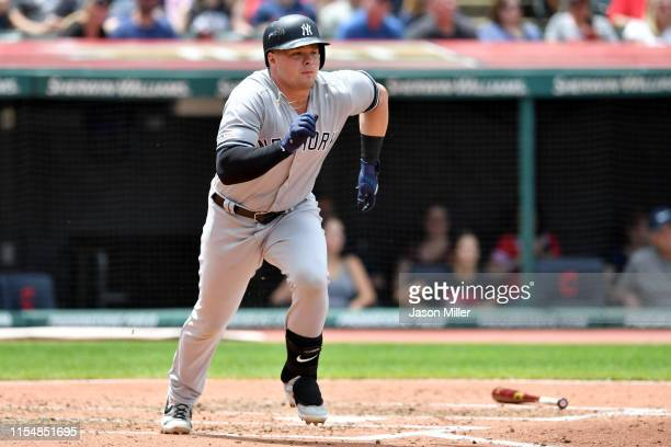 Luke Voit of the New York Yankees runs out a two RBI double during the second inning against the Cleveland Indians at Progressive Field on June 09...