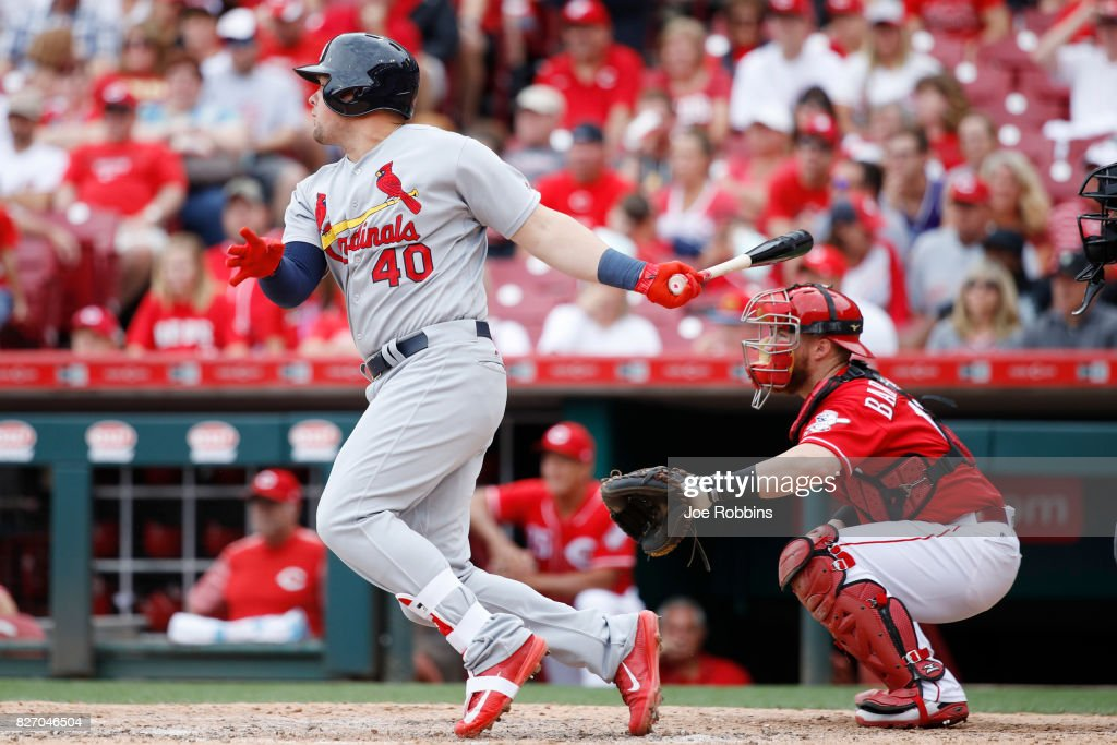 Luke Voit #40 of the St. Louis Cardinals hits a ground rule double to drive in two runs in the fourth inning of a game against the Cincinnati Reds at Great American Ball Park on August 6, 2017 in Cincinnati, Ohio. The Cardinals defeated the Reds 13-4.