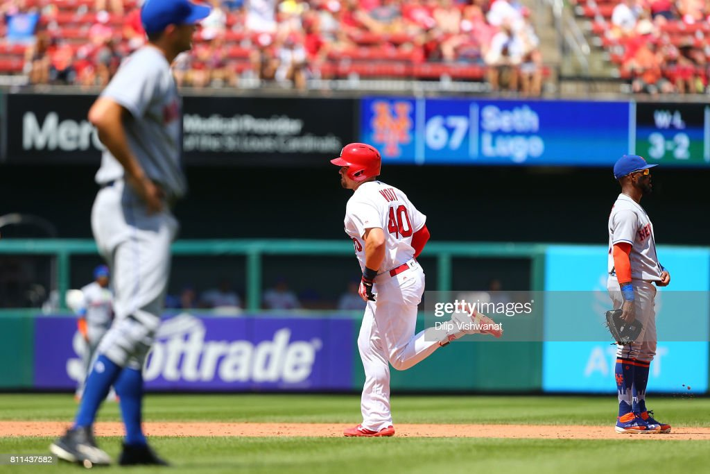 Luke Voit #40 of the St. Louis Cardinals rounds the bases after hitting a home run as Jose Reyes #7 of the New York Mets looks on in the sixth inning at Busch Stadium on July 9, 2017 in St. Louis, Missouri.