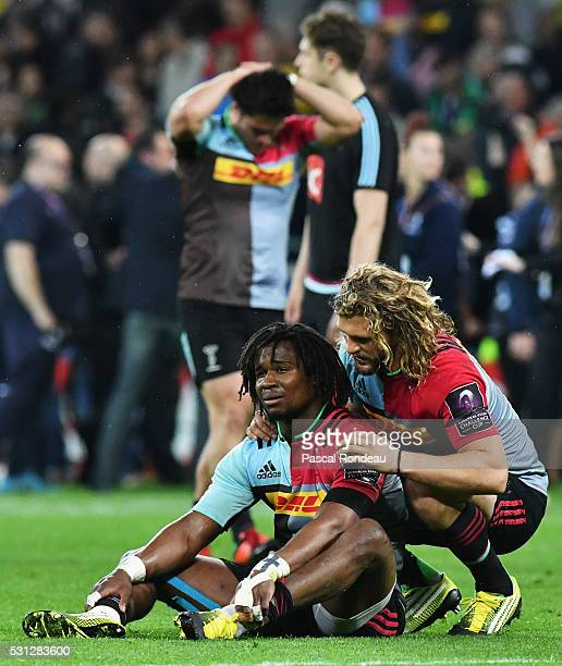 Luke Wallace and Marland Yarde from Harlequins appear dejected at the end of the match during the European Rugby Challenge Cup Final match between...