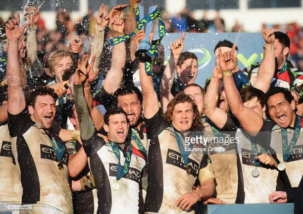Luke Wallace of Harlequins lifts the trophy with team mates after the LV= Cup Final between Sale Sharks and Harlequins at Sixways Stadium on March 17...