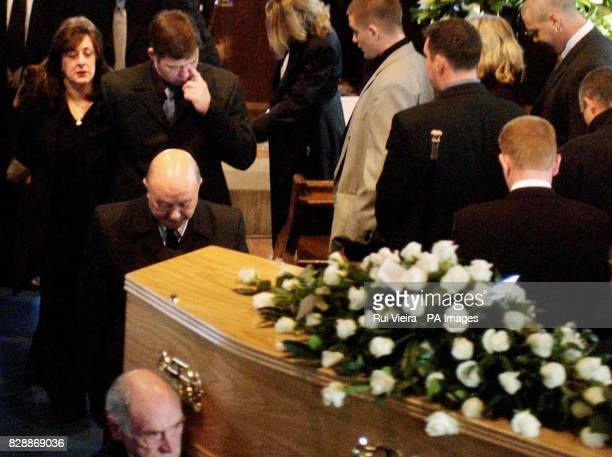 Luke Walmsley parents Jayne and Paul walk behind the his coffin as they leave St Mary's Church after their son's funeral in North Somercotes Luke was...