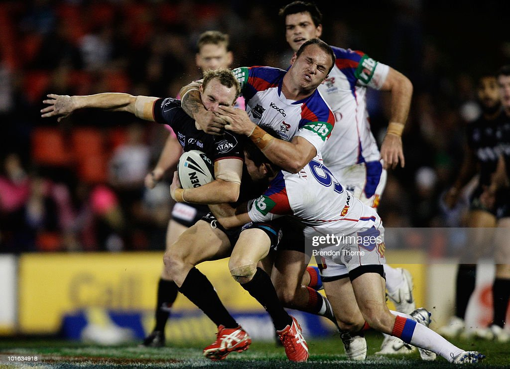 Luke Walsh of the Panthers is tackled by the Knights defence during the round 13 NRL match between the Penrith Panthers and the Newcastle Knights at CUA Stadium on June 5, 2010 in Sydney, Australia.