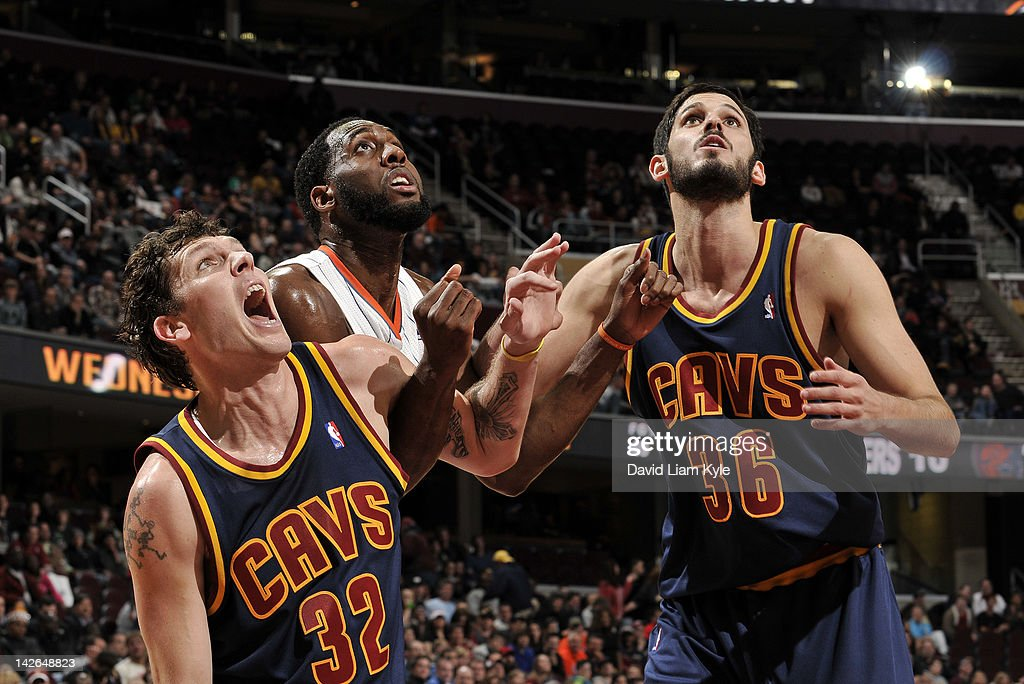 Luke Walton #32 and Omri Casspi #36 of the Cleveland Cavaliers box out D.J. White #8 of the Charlotte Bobcats for the rebound at The Quicken Loans Arena on April 10, 2012 in Cleveland, Ohio.