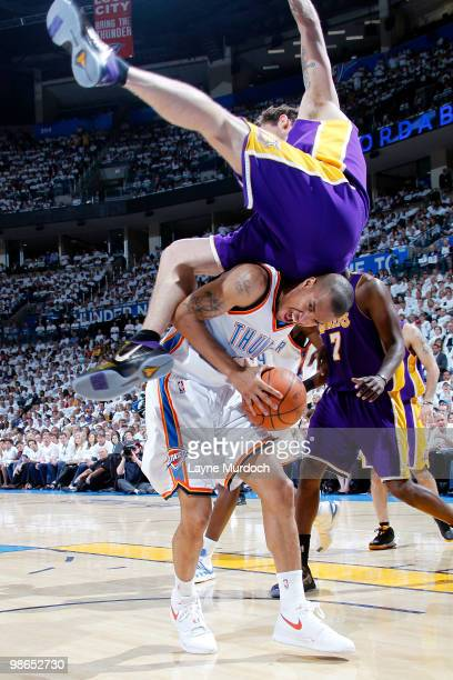 Luke Walton of the Los Angeles Lakers flips over Eric Maynor of the Oklahoma City Thunder in Game Four of the Western Conference Quarterfinals during...