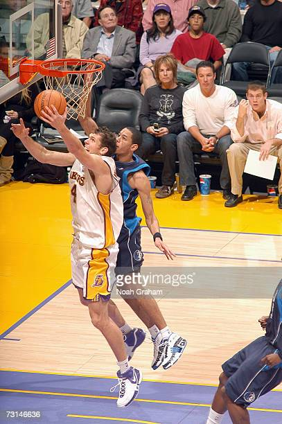 Luke Walton of the Los Angeles Lakers goes to the basket against Devin Harris of the Dallas Mavericks on January 7 2007 at Staples Center in Los...