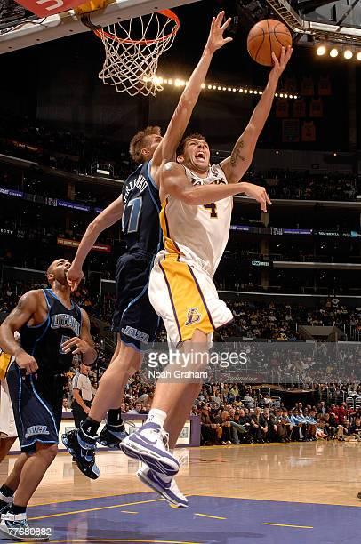 Luke Walton of the Los Angeles Lakers goes to the basket against Andrei Kirilenko of the Utah Jazz at Staples Center on November 4 2007 in Los...